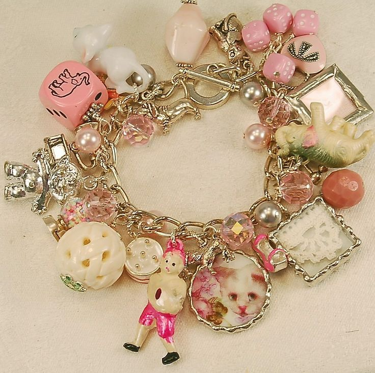 PLAYFUL PINK VINTAGE CHARM BRACELET. $176.00, via Etsy.   Check the price on this piece!