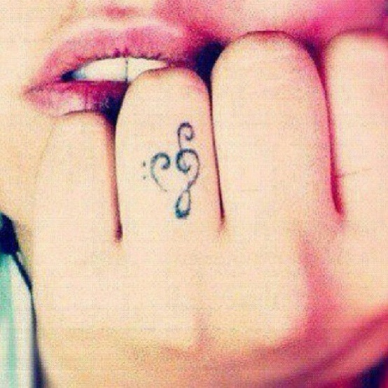 Treble bass clef heart finger tattoo tattoos aj for Treble and bass clef heart tattoo