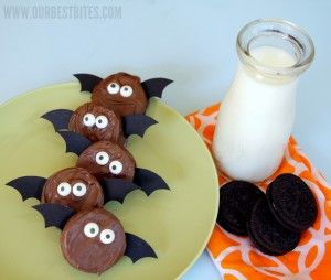 Oreo Bats  Use  cardstock to prepare the bat wings. Set aside.    If making pops, insert the lollipop sticks into the creme filling of the Double Stuft Oreo. Set aside.    Melt the chocolate according to the directions on the package. Dip the Oreos in the chocolate, smoothing away the excess chocolate. Add the eyes, wings, and fangs (if desired) and allow to set completely.