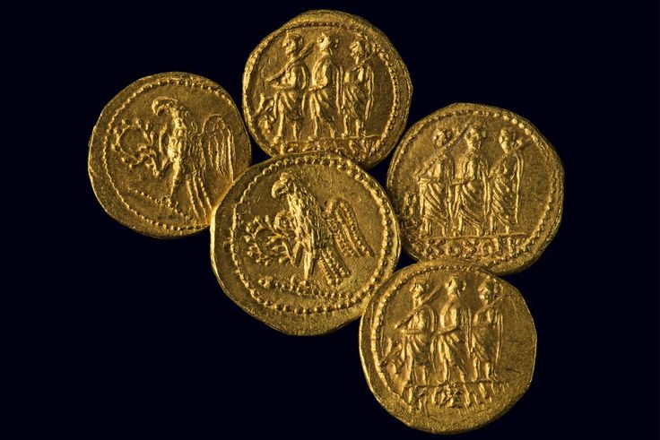 Picture of gold coins with Roman imagery. Dacians fashioned gold into coins, as well as jewelry. These coins, like the bracelets, were looted from the site of Sarmizegetusa, the Dacian capital, and recovered in recent years.