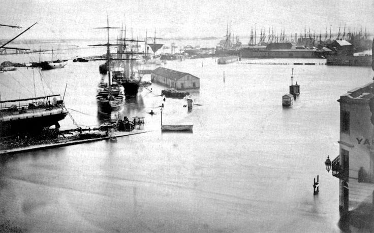 The Yarra River in flood, 1863. Flinders Street is in the foreground, marked by the corner of a building, probably the Yarra Yarra Hotel