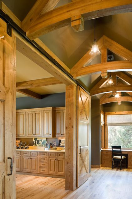 farmhouse hall by Alan Mascord Design Associates Inc - barn doors close off the kitchen, when you are entertaining.