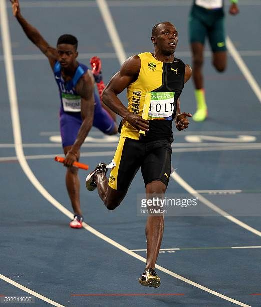 Usain Bolt of Jamaica crosses the finishline to win the Men's 4 x 100m Relay Final on Day 14 of the Rio 2016 Olympic Games at the Olympic Stadium on...