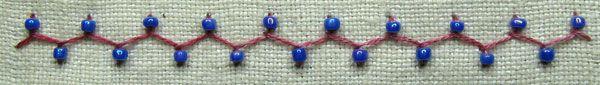 Cretan stitch with a bead on each arm