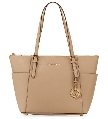 Jet set top-zip saffiano tote bag by MICHAEL Michael Kors. MICHAEL Michael Kors saffiano leather tote bag with golden hardware. Thin, flat shoulder straps with adjustable buckl...