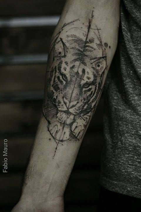 Sketch work style tiger tattoo on the right inner forearm.