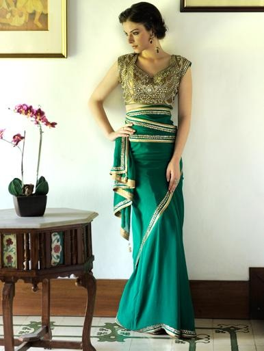 Too much stone work on the blouse but the shape is nice. The color of the sari is divine and the fabric is silk georgette.