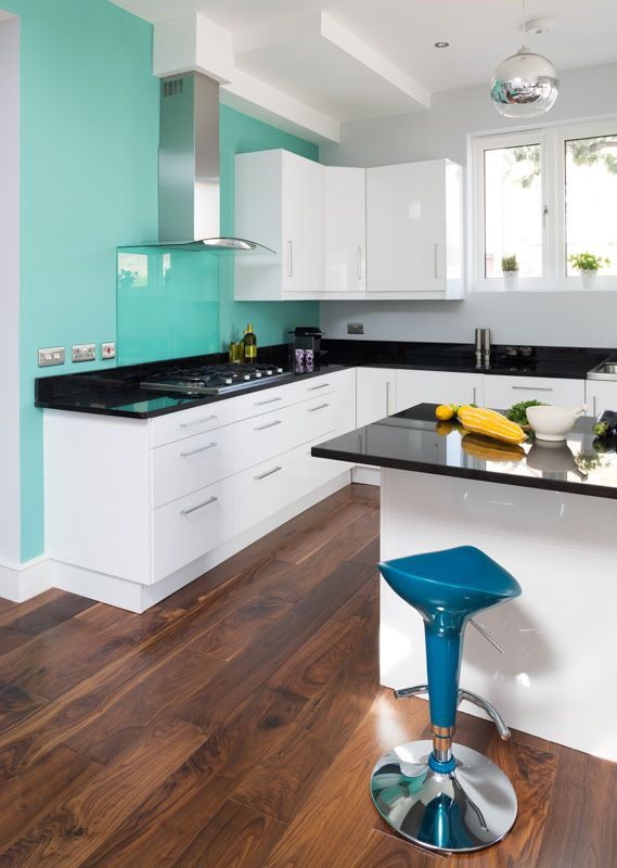 Dont think i like the feature wall that colour but i do love the dark floors and white kitchen :)