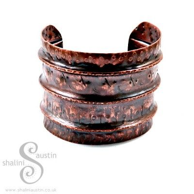 Wearable Copper art cuff, cut individually from copper sheet and designed using a technique called fold forming which involves a lot of annealing and lots of hammering.This piece reminds me of the beautiful woven borders on Indian Sarees so I am going to call this style of fold formed cuff  'Saree 'This is a wide Cuff. Width is 5 cm and it is a standard fit at approximately 6.5