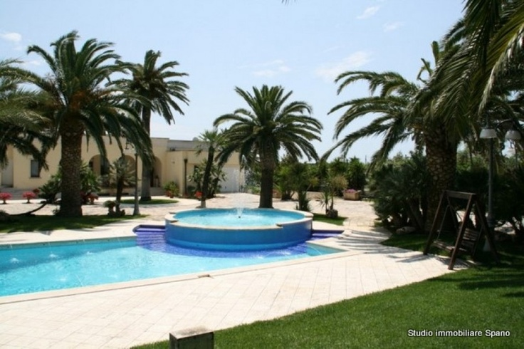 Luxury villa with pool for sale in Puglia, Italy, on the Ionian west coast of Salento area. This fantastic property is set within 8.000 sqm of land with English lawn, ornamental plants and trees, swimming pool and car parking. The villa spread over two levels, raised and lower ground floor, boasts reception, living room, formal dining room, kitchen, 4 double bedrooms, 4 bathrooms, storages rooms, front veranda and a nice backyard for al-fresco dining.