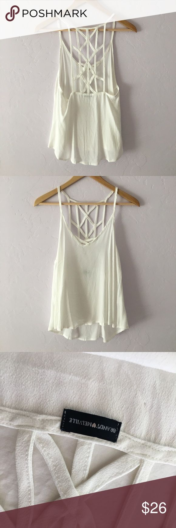 Brandy Melville Caged Back Tank White crepe Brandy tank with intricate strappy caged racerback. Worn once to the beach and has sat in my closet ever since. In perfect condition with no signs of wear. Brandy Melville Tops Tank Tops