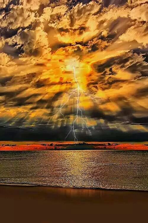 Wow, this is awesome. Sunset and lightning over water.