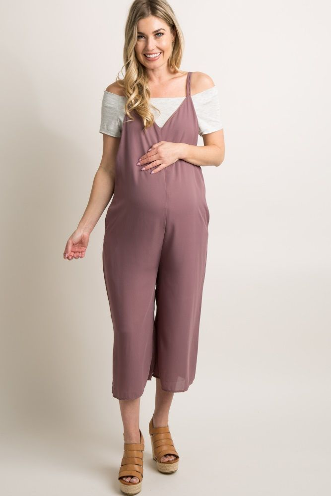 af44c7ca84b8 Mauve Chiffon Wide Leg Cropped Jumpsuit A solid chiffon maternity jumpsuit  featuring double cami straps, a v-neckline and back, a cropped wide-leg  style and ...