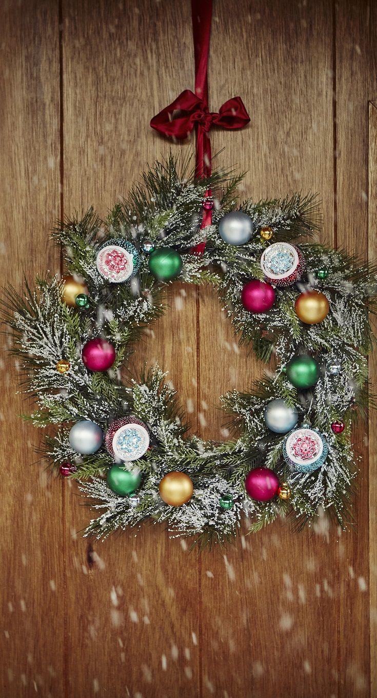 Start your Christmas wonderland from the outside in with our snowy decorated wreath