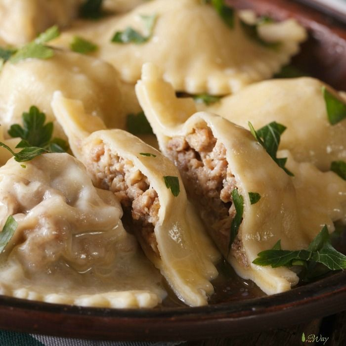Homemade Italian Ravioli with meat and cheese filling is exactly what you\'d be find at a restaurant in Italy. Little pockets full of flavorful meat and cheese. #homemade_ravioli, #homemade_pasta,#ravioli, #meat_cheese_filling_for_ravioli, # authentic_ravioli,#Italian_ravioli