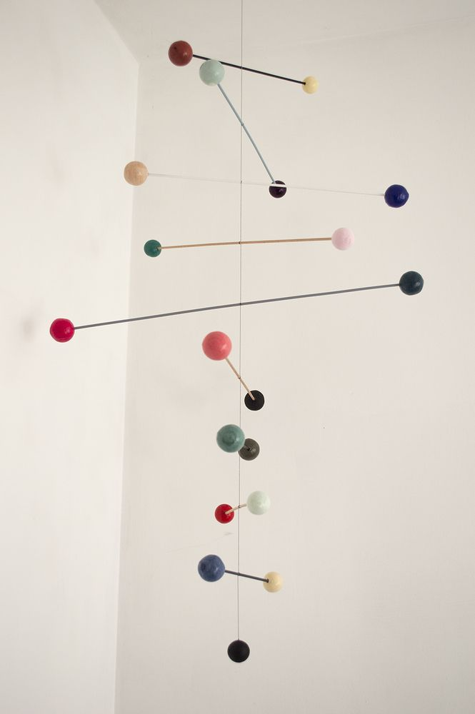 Handmade mobile by Belgian artist Renilde de Peuter.l 70 cm w 40cm (widest point)  total drop approx 2 metres ( adjustable by the string)Each mobile is unique with a different colour palette, perfectly balanced . Great in any room. Made with hand painted craft balls, wood, cotton thread.Please note, write on your order which one you like to purchase: number 1 first and second pictures, number 2 third and four pictures. Posted fully trackable and insured