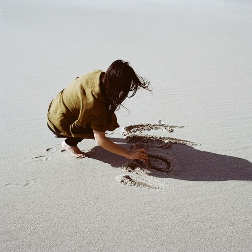 """writing in sand what the sea can make it to become its secret"""" (m)"""