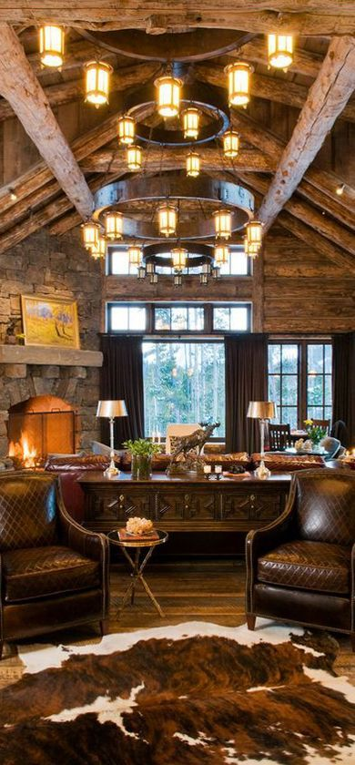 Love the cow hide decor in the rustic cabin!