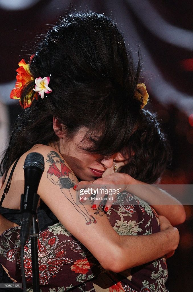 British singer Amy Winehouse (L) hugs her mother Janis Winehouse after accepting a Grammy Award at the Riverside Studios for the 50th Grammy Awards ceremony via video link on February 10, 2008 in London, England. Winehouse won 5 out of her 6 nominations including, record of the year, best new artist, song of the year, pop vocal album and female pop vocal performance.