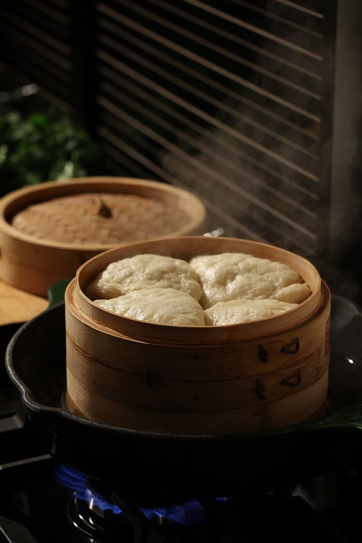 Homemade bao buns can be steamed in a traditional bamboo vessel, or in a more common metal steamer. (E. Jason Wambsgans/TNS)