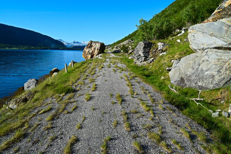 Old abandoned road in Norway right next to the sea
