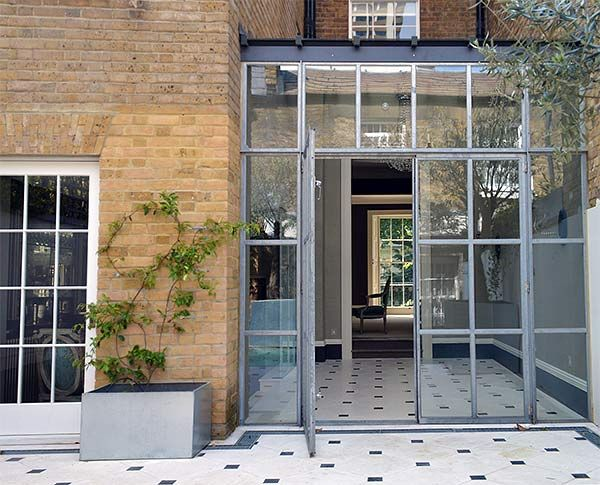 Extending a five storey listed house in a Kinghtsbridge square: a conservatory…