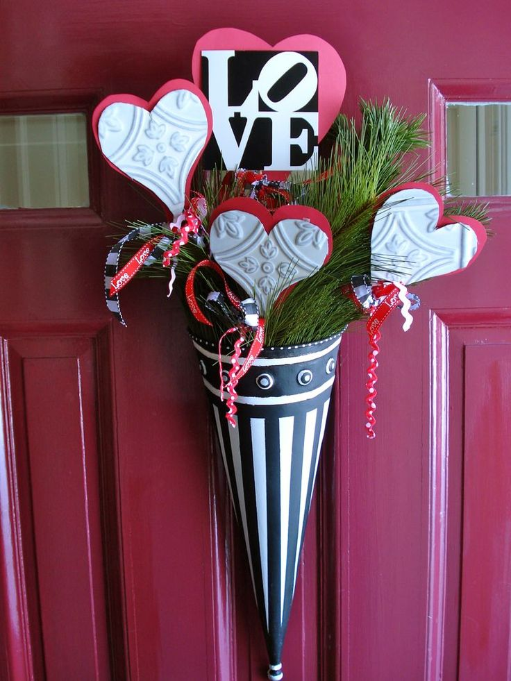 Decoration for door, cone filled with Valentine's hearts, misc. I picked up some metal cones at the dollar store, wondered what the best project for them might be.  This looks like this might be it.