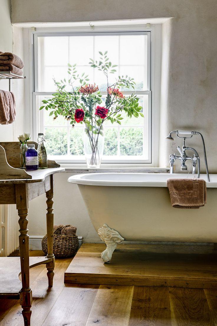 Cottage bathroom, clawfoot tub, wood floors, wood washstand...
