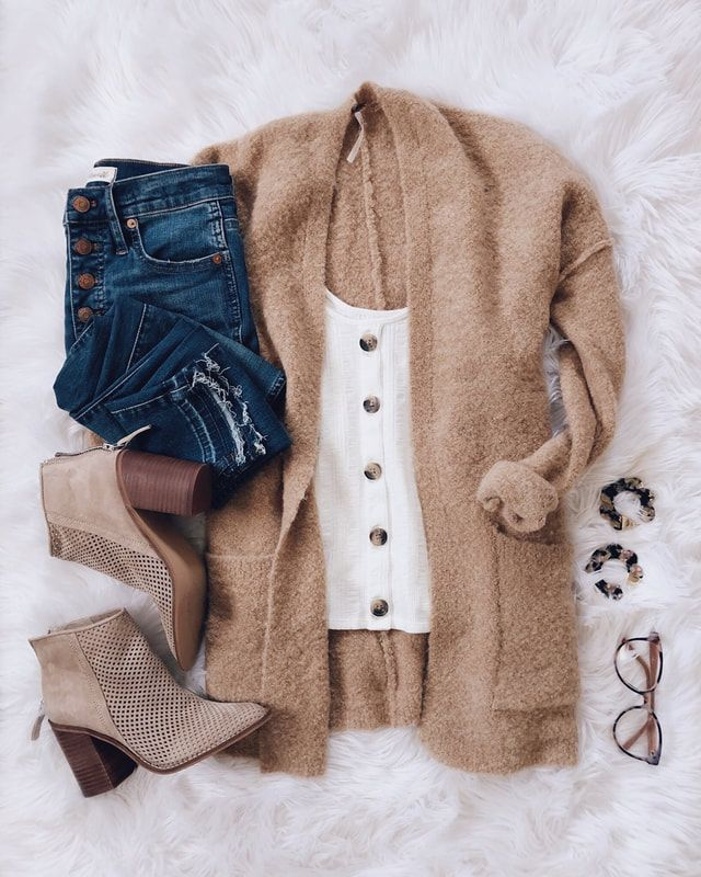 Incredibly classic white blouse with brown buttons paired with a brown cardigan and booties…