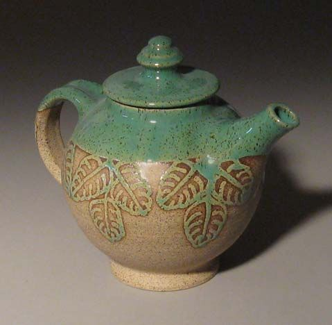 Stoneware pottery teapot. Sorta looks like a water jug to me.