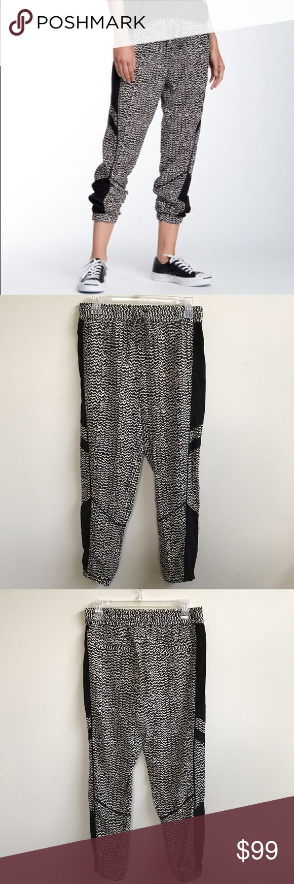 Pam & Gela : silk track pants New and never worn black and white 100% silk track pants / joggers. Size S / Petite. No PayPal, holds or trades. Bundle to save. 💸 Open to offers! Pam & Gela Pants Track Pants & Joggers