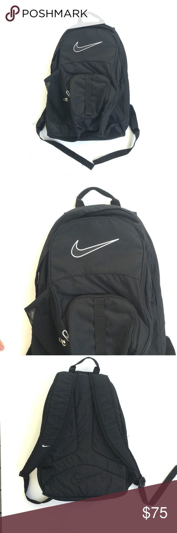 NWOT Black nike backpack Never used as I was medically outed from my private school track and field team and all college sports :/ bought the bag before this happened. Small embroidered section that could probably be removed by a seamstress and a seam ripper. Black nike backpack. 21x14 approx. 4 big pockets- plus inner pockets - and mesh water bottle section. Nike Bags Backpacks