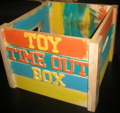Toy Time Out Box - a place to put a toy for a set amount of time (the day usually) when it is taken away.