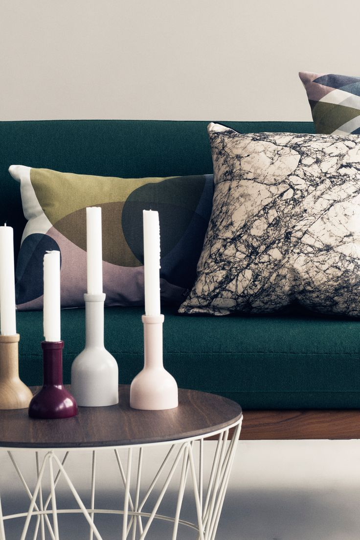 """The idea for ferm LIVING's Winebottle Candleholders came from the famous scene in """"Lady and the Tramp"""" where Lady and the Tramp share a candlelit dinner at Tony's. On the table you see a winebottle with a candle in it. The Winebottle Candleholders are meant to recreate the feeling while also adding a twist - the candleholders are made of beech wood and come in different sizes."""