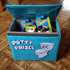 Modified diaper box wrapped in gift wrap to keep potty-training rewards in. #parenting #pottytraining #parenting