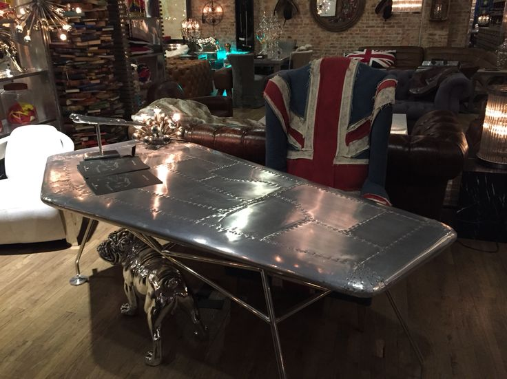 Love this airfoil desk with distressed Union Jack chair look from ABC
