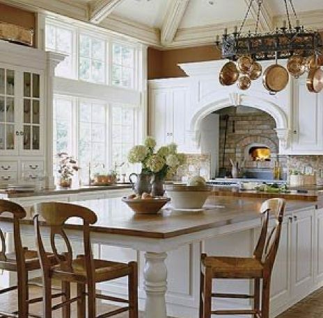wood counter top - table is extension of counter and is that a little fire place above the stove?
