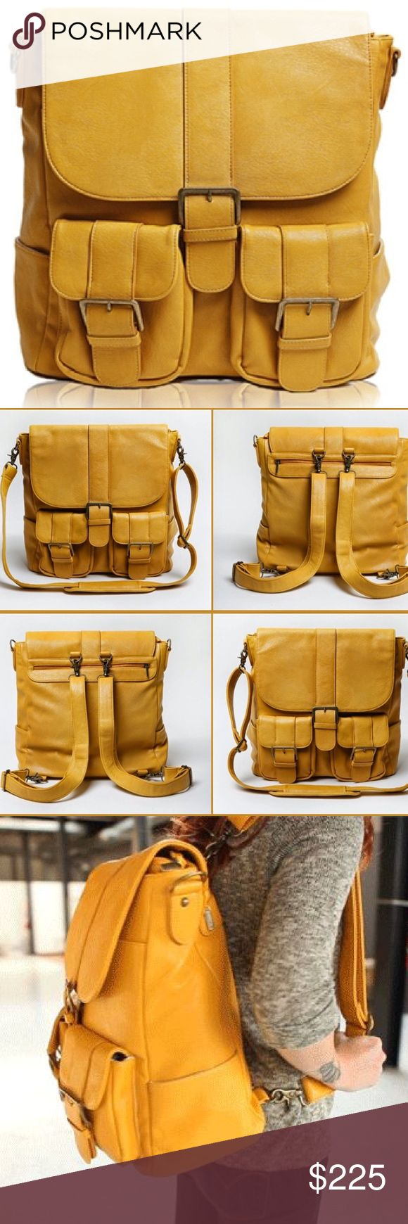 """Rare Epiphanie Brooklyn Camera Bag Backpack Gorgeous mustard Brooklyn camera bag/backpack from Epiphanie combines function and style. Can carry a DSLR w/attached lens, 2 extra lenses, flash w/battery pack, accessories and a 15"""" laptop and/or tablet. Has plenty of pockets and 4 interior panels allow you to configure the bag to your liking. Or, remove all panels for one large storage space. Includes 2 detachable shoulder straps + detachable cross-body strap. Made from water-resistant synthetic…"""