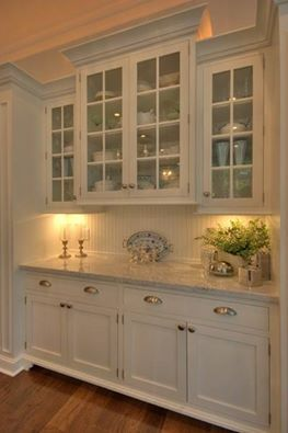 Marble, bead board, white cabinets and glass doors = very nice!