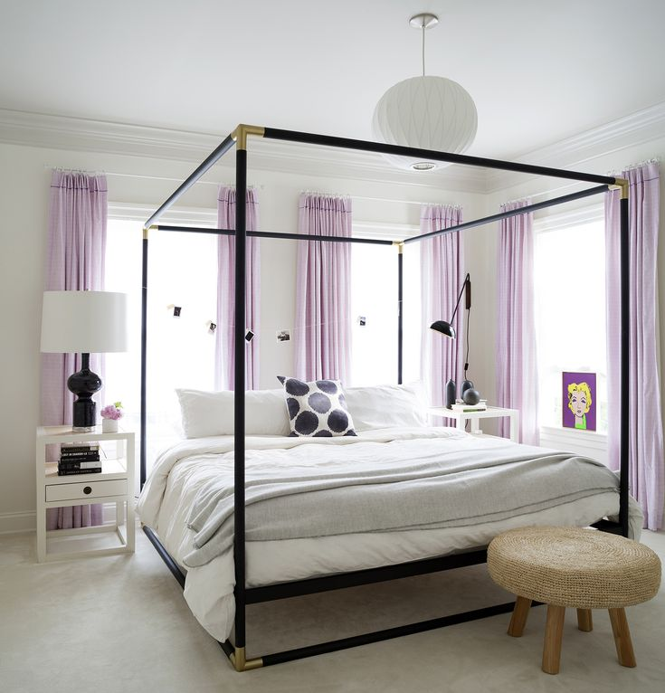 Lavender curtains and accents in a beautiful teen bedroom by Ella Scott Design. Black poster bed and urban chic accents. Come see the Before & After: Fussy Traditional to Urban Chic! #teenbedroom #lavender #posterbed #blackbed #urbanchic #moderndesign