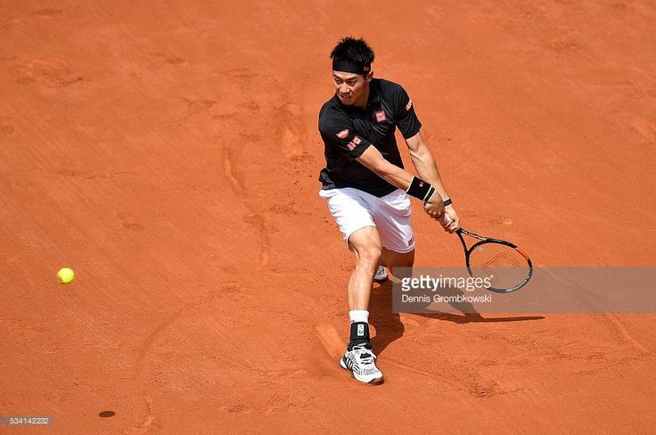 Kei Nishikori of Japan plays a backhand during the Men's Singles second round match against Andrey Kuznetsov of Russia at Roland Garros on May 25, 2016 in Paris, France.