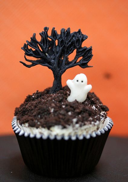 cupcake design chocolate decorations on top of crumbled oreos - Cute Halloween Cupcake Decorating Ideas