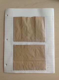 Brown paper bags make great pockets in notebooks