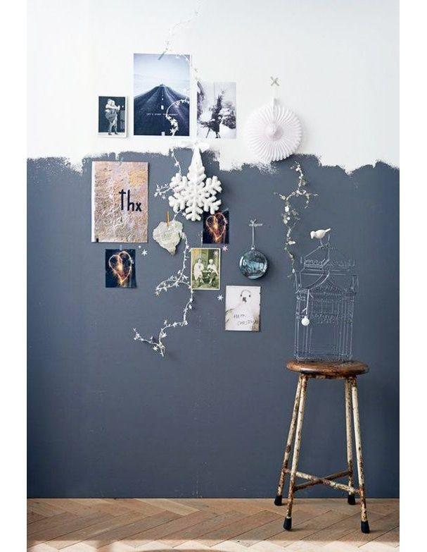 Un mur peint majoritairement en gris à main levée