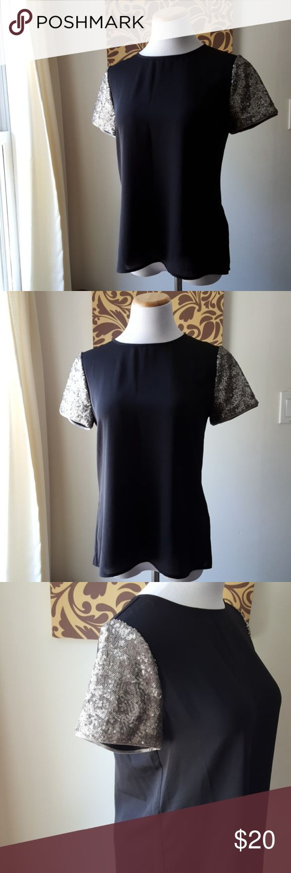 Banana Republic Heritage Sequin Sleeved Top Like new condition. No stains or stains. The shirt is a light material. Sleeves are small silver sequins. Small open detail on back. Material does not stretch. Busy measures 19 inches. Shirt meausres 24 inches from shoulder to hem line. Banana Republic Tops Tees - Short Sleeve