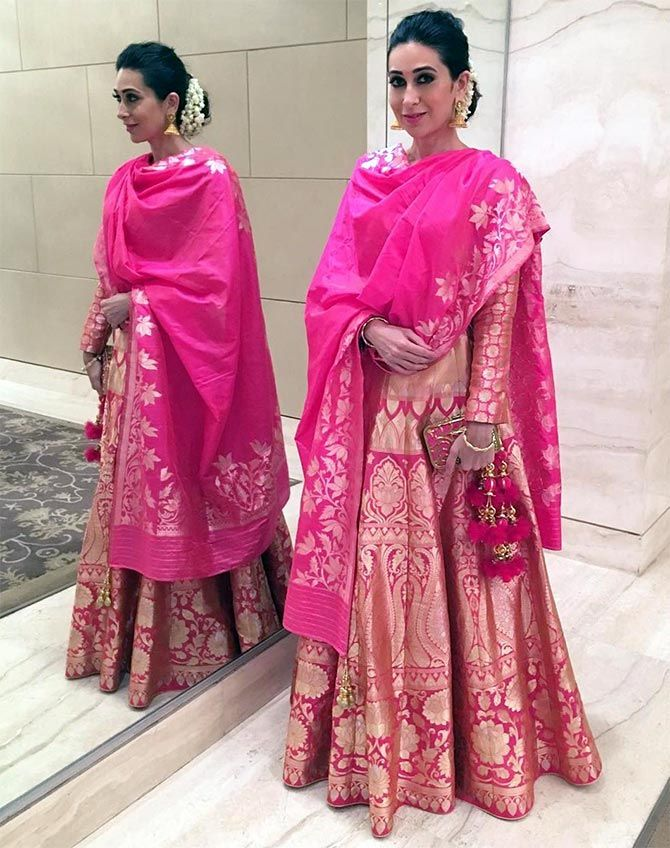 Opting for a beautiful pink embroidered silk lehenga, Karisma Kapoor looks the classy style icon she is. She Wears Handloom. Do you? GiftPiper.com- committed to the cause of Indian weaves and crafts.