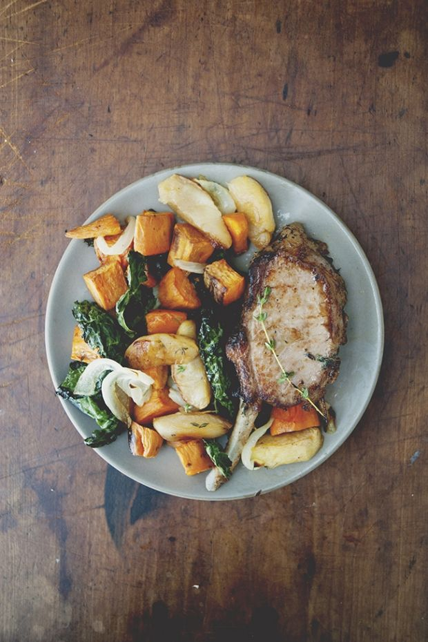 Epic pork chop with roasted apples, yams, and kale