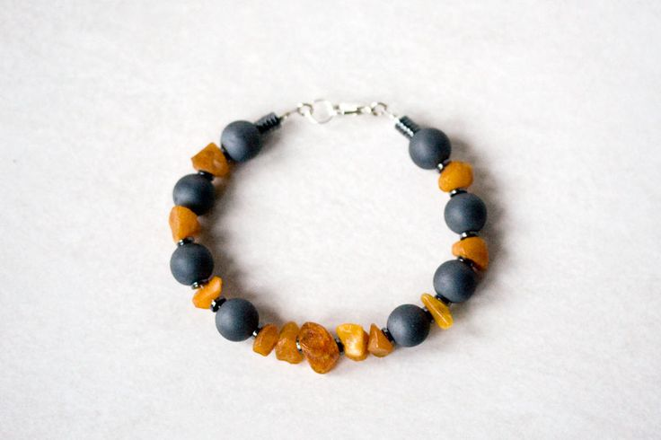 Raw amber chunks and hematite spheres €25