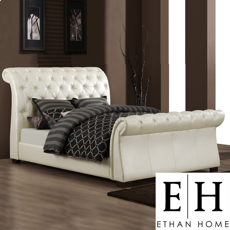 Anchor your bedroom in cream white elegance with this faux leather queen sleigh bed from Castela. The soft tufted headboards and footboards on the bed contrast with the rich, dark Asian wood to create a luxurious, sophisticated look....more