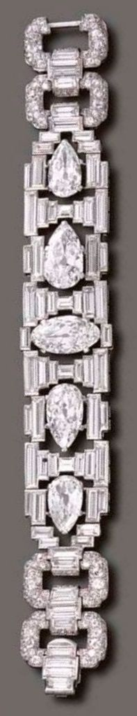 A MAGNIFICENT ART DECO DIAMOND BRACELET, BY CARTIER, CIRCA 1927. The openwork baguette-cut diamond geometric band, of flexible design, centring upon a marquise-cut diamond flanked on either side by pear-shaped diamonds, joined by pavé-set diamond links and baguette-cut diamond arched spacers, mounted in platinum, signed Cartier, numbered. #Cartier #ArtDeco #bracelet